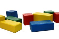 Wooden colourful childrens blocks Stock Photos