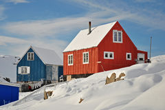 Wooden colourful cottages. Houses in the Kulusuk village, Greenland Stock Photo