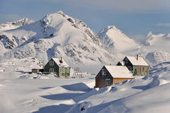 Wooden colourful cottages in winter. Houses in the remote Kulusuk village, Greenland Royalty Free Stock Image