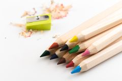 Wooden colorful pencils isolated on a white background, pencil sharpeners stock images