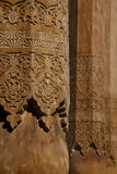 Wooden columns with carved in the mosque Royalty Free Stock Photography