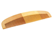 Wooden Comb. On a white background Royalty Free Stock Photo
