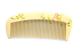 Wooden comb. Beautiful closeup shot of wooden comb royalty free stock photography