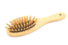 Wooden comb brush Royalty Free Stock Image