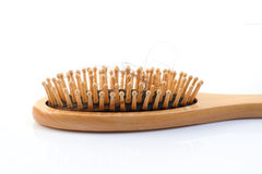 Wooden comb brush with lost hair Stock Image