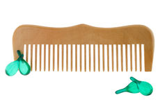 Wooden comb with capsules of Hair vitamin serum isolated on whi stock images