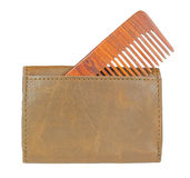 Wooden comb in leather wallet. Stock Images