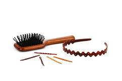 Wooden comb, some hair pins and hoop Stock Photos
