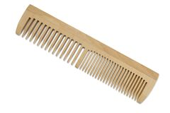A wooden comb with teeth of different widths. Wooden comb with teeth of different widths on isolated background Royalty Free Stock Images