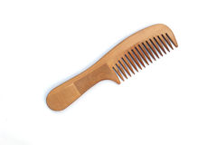 Wooden comb. Is on white background Stock Photos