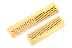 Wooden combs isolated on white background Stock Photos