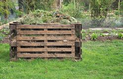 Wooden compost bin. For organic waste in a garden Stock Photo