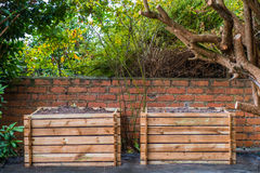 Wooden Compost Bin. Two wooden compost bins in a back garden Royalty Free Stock Images