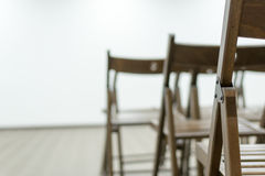 Wooden Conference Chairs and Display Stock Images