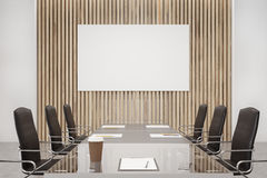 Wooden conference room, poster. Wooden conference room interior with a long table with reflecting surface, clipboards lying on it and two rows of black office Stock Photography