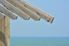 Wooden construction at seaside. Wooden construction as shield at seaside, shown as enjoy time at beach and holiday life Royalty Free Stock Photos