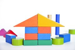 Wooden constructions for children play. Wooden colored blocks, construction game, part of a series, closeup Royalty Free Stock Photo