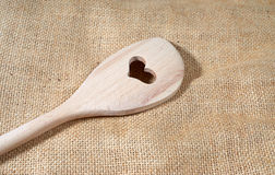 Wooden cooking Spoon. With heart cutout Stock Photos