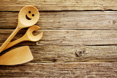 Wooden cooking utensils border Stock Images