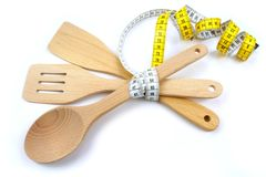Wooden cooking utensils and tape measure. Stock Photography