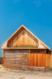 Wooden cottage. Wooden  cottage and blue sky Stock Image