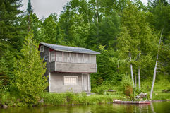 Wooden Cottage By Lake In Ontario, Canada Stock Images