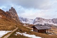 Wooden cottage in dolomities alps Italy stock photo