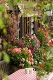 Wooden cottage with flowers Stock Images