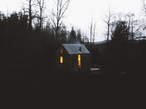 Wooden cottage in forest Royalty Free Stock Photography