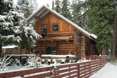 Wooden cottage in forest in winter Stock Photo