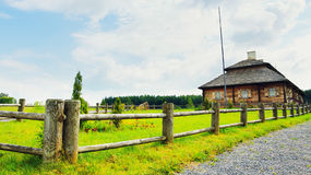Wooden cottage on green hill Stock Photography
