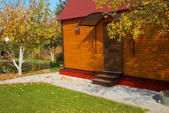 Wooden cottage house. And pond stock photography