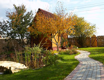 Wooden cottage house. In the autumn royalty free stock image