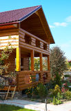 Wooden cottage house. In the autumn stock images