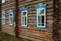 Wooden cottage house blue  windows Stock Photo