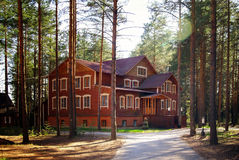 Wooden cottage house blue  windows Stock Image