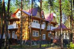 Wooden cottage house in the forest Royalty Free Stock Photo