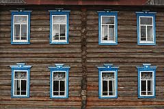 Wooden cottage house windows Royalty Free Stock Images
