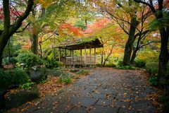 A wooden cottage inside Gifu park in autumn, Gifu, Japan. View of a wooden cottage inside Gifu park in autumn, Gifu, Japan stock photo