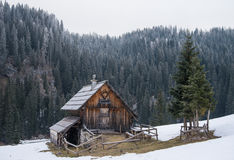 Wooden cottage on meadow in Julian Alps Stock Images