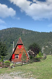 Wooden cottage on mountain Stock Photo