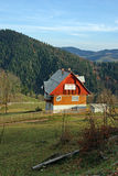 Wooden cottage in mountain valley royalty free stock photos