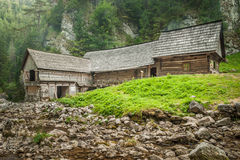 Wooden cottage in the mountains with creek Stock Image