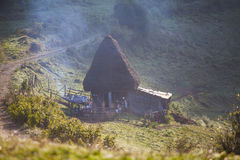 Wooden cottage in the mountains Royalty Free Stock Photo