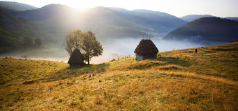 Wooden cottage in the mountains Stock Photo