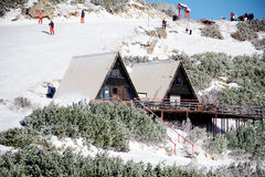 Wooden cottage on the peak of a Snow Mountain Royalty Free Stock Image
