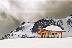 Wooden cottage on peak of Yulong Royalty Free Stock Images