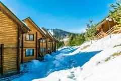 Wooden cottage among pine forest. Comfortable accommodation in the ski resort Bukovel. Polianitsa village, Ivanofrankivsk region, Ukraine - February 26, 2019 stock photos