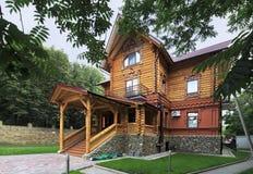 Wooden cottage in the resort Belokuriha Royalty Free Stock Photos