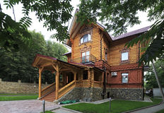 Wooden cottage in the resort Belokuriha Royalty Free Stock Images
